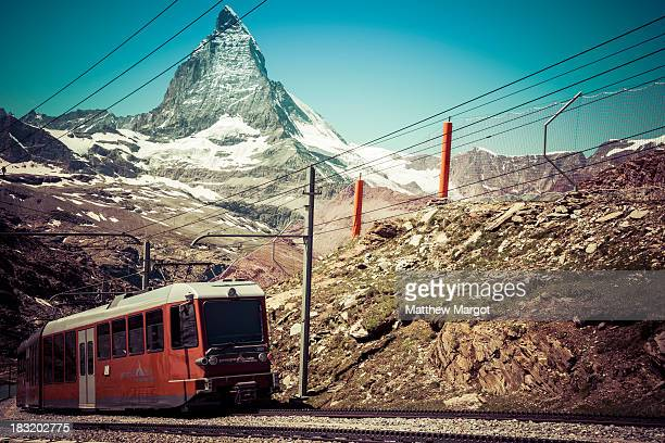 CONTENT] Train heading up to the Gornegrat with the Matterhorn in the background
