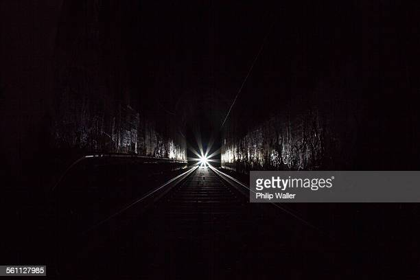 train in dark tunnel - light at the end of the tunnel stock pictures, royalty-free photos & images