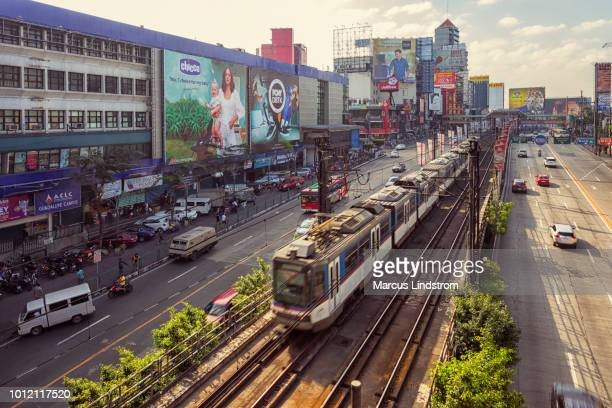 mrt train in manila - manila philippines stock pictures, royalty-free photos & images