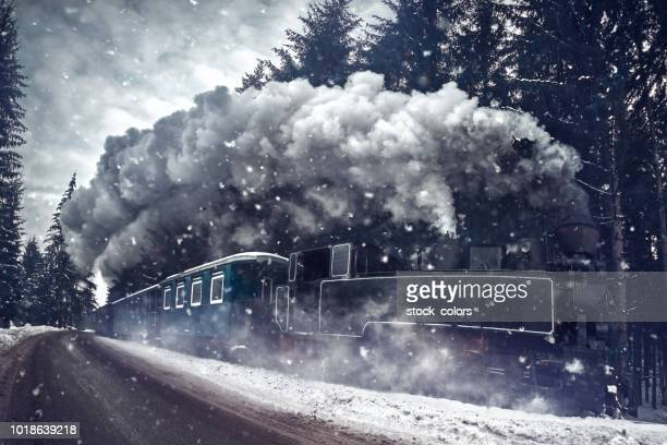 train in the winter - locomotive stock pictures, royalty-free photos & images