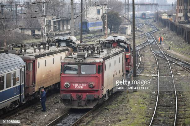 A train is pictured near the North Railway Station in Bucharest Romania on February 12 2018 Romania has record economic growth the highest in the EU...