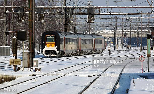 A train is seen at the snow covered railway of Mons on December 20 2010 Eurostar and Thalys trains linking France with Britain and Belgium continued...