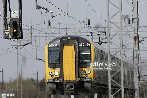 A train is seen leaving Crewe Station on April 28 Crewe United Kingdom The threat of a nationwide rail strike in a row over pensions has moved a step...