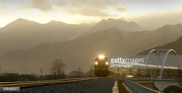 A train leaves the Tibetan capital Lhasa on its way to Beijing at first light 02 March 2007 Since it opened eight month ago China's rail link to...