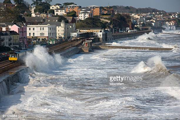 train leaving dawlish station in a storm - gale stock photos and pictures