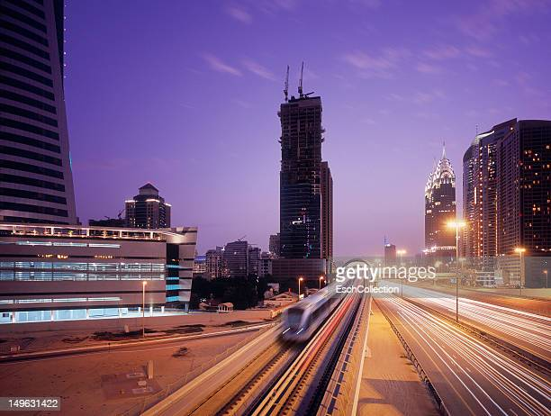 Train leaving futuristic metro station in Dubai