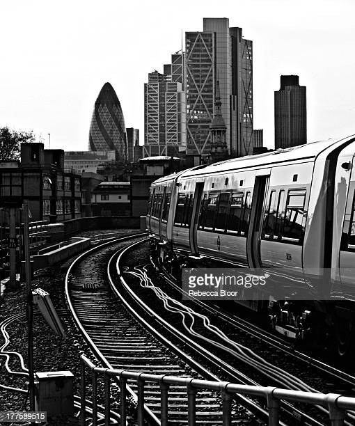 CONTENT] Train leaving Hoxton Overground Station with City of London in distance Hoxton East London 2012
