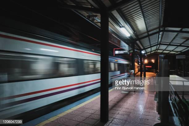 train leaving station - finn bjurvoll stock-fotos und bilder