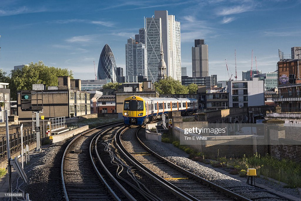 Train leaving the city, London UK : Stock Photo
