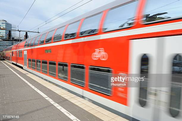 train leaving the station - double decker bus stock pictures, royalty-free photos & images