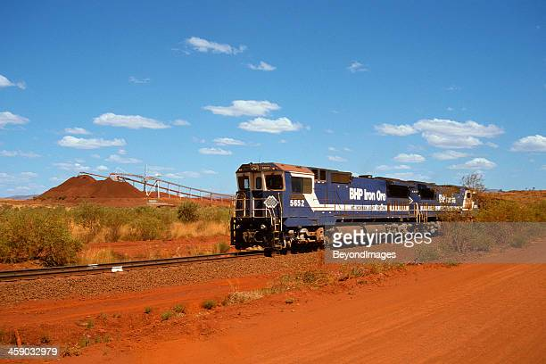 bhp train loading iron ore at yandi mine - iron ore stock photos and pictures