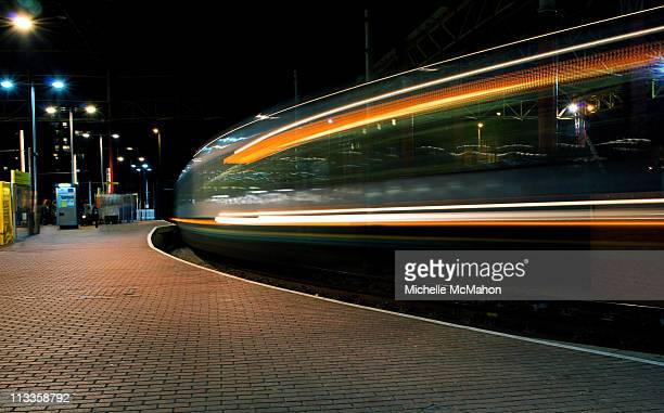 train motion blur.. - victoria station manchester stock pictures, royalty-free photos & images