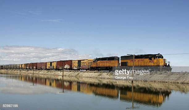 A train moves along the Great Salt Lake April 5 2005 near Grantsville Utah The Great Salt Lake is located approximately 35 miles west of Salt Lake...