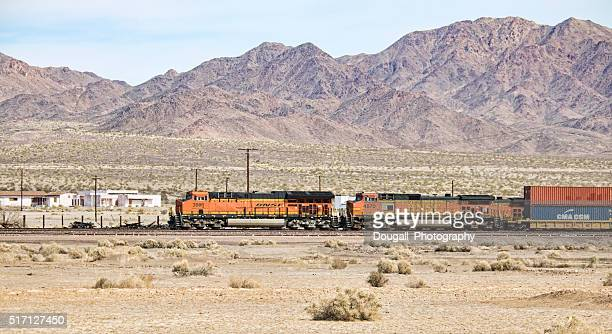 bnsf train moving past amboy california in mojave desert - amboy california stock photos and pictures