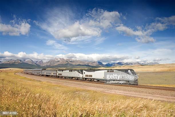Train moving through rural field