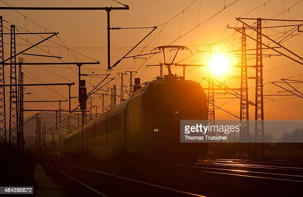 A train of Deutsche Bahn on a electrified railway during sunset on October 31 2010 in Neudietendorf Germany