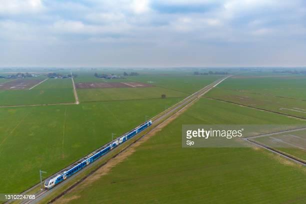 "train of keolis and overijssel province driving on the kamperlijntje in a rural landscape - ""sjoerd van der wal"" or ""sjo"" stock pictures, royalty-free photos & images"