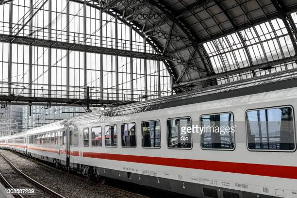 """train of the deutsche bahn (db leaving amsterdam central station - """"sjoerd van der wal"""" or """"sjo"""" stock pictures, royalty-free photos & images"""
