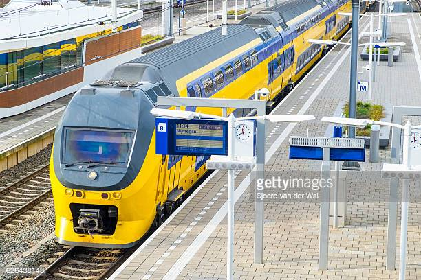 """train of the dutch railways or ns at arnhem station - """"sjoerd van der wal"""" stock pictures, royalty-free photos & images"""