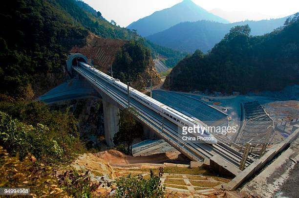 A train of Wuguang Highspeed Railway runs through the Dayao Mountain Tunnel on December 8 2009 in Shaoguan of Gungdong Province China The Wuguang HSR...