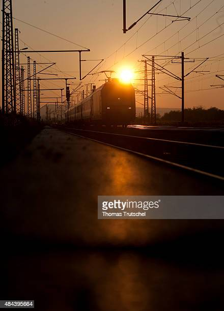 A train on a electrified railway during sunset on October 31 2010 in Neudietendorf Germany
