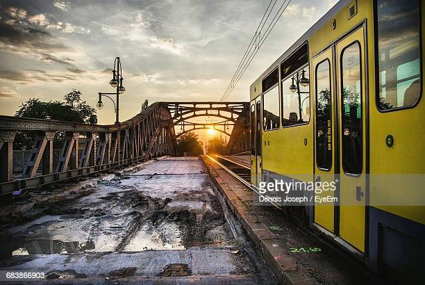Train On Bridge Against Sky During Sunset
