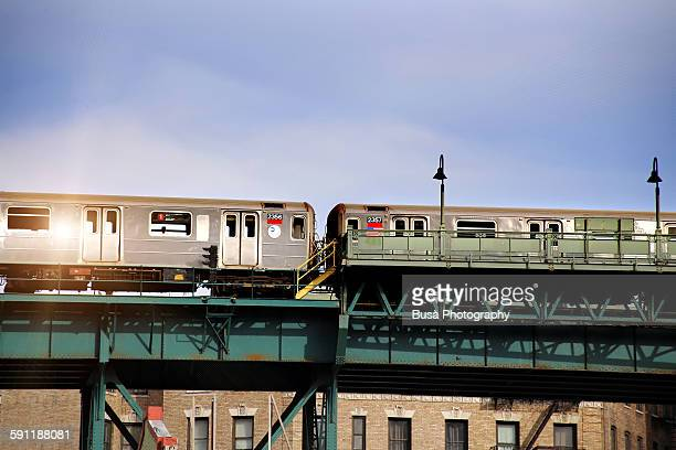 train on elevated railway tracks in harlem - elevated railway track stock pictures, royalty-free photos & images