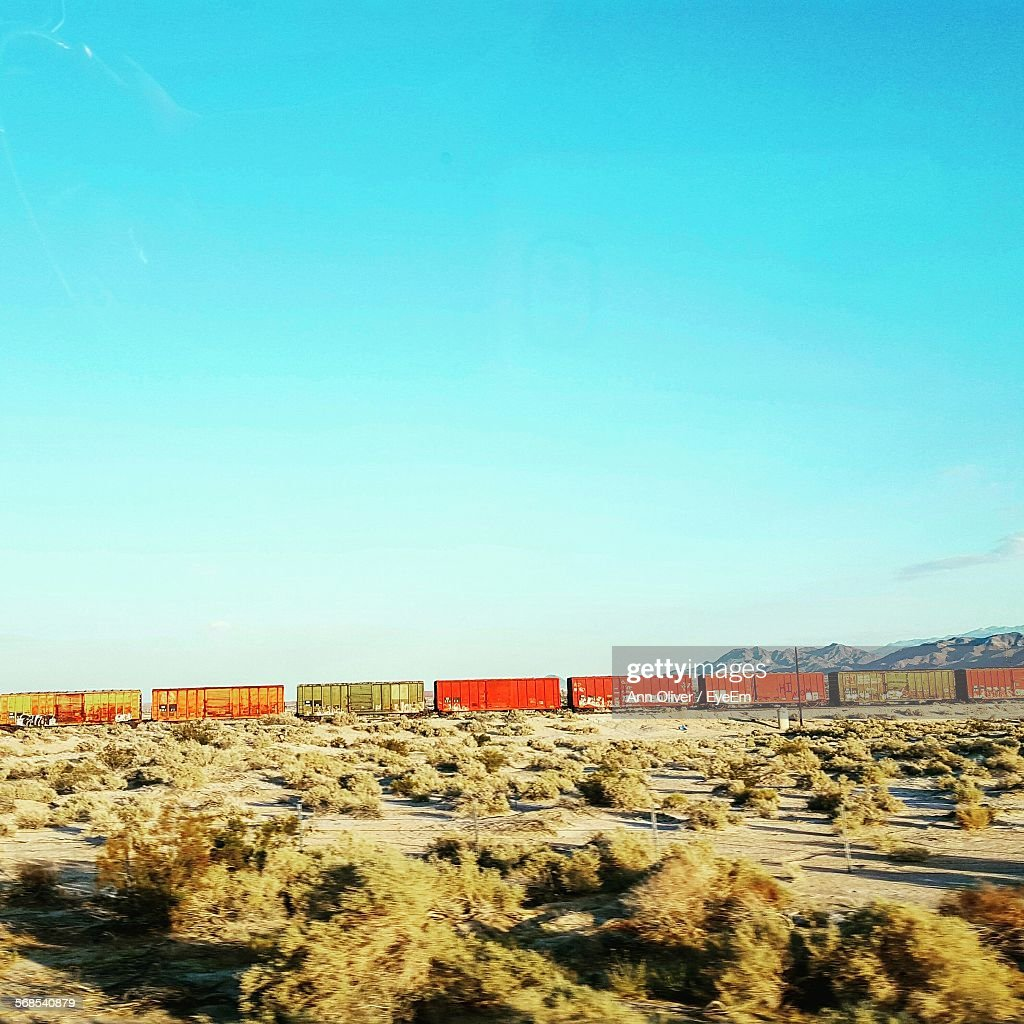 Train On Field Against Clear Sky : Stock Photo