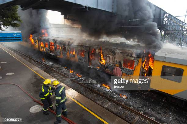 train on fire - terrorism stock pictures, royalty-free photos & images