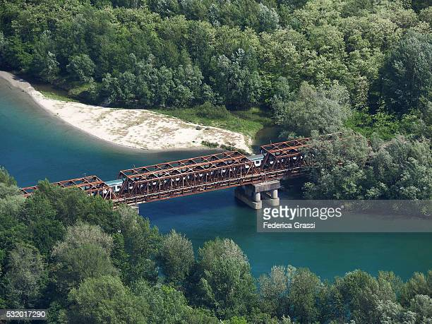 Train  On Iron Railway Bridge Crossing The River Toce In Northern Italy