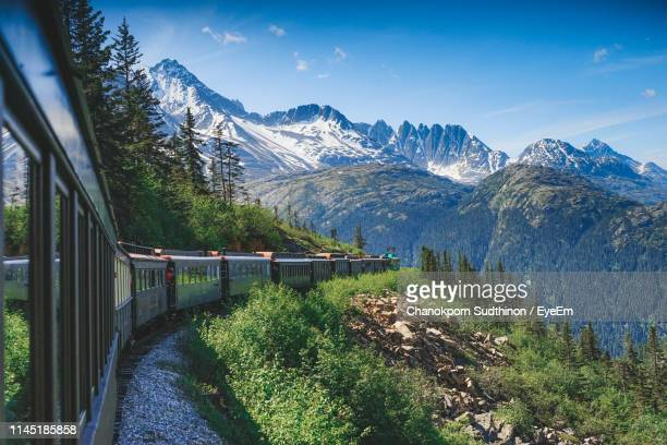 train on mountain during winter - rocky mountains north america stock pictures, royalty-free photos & images