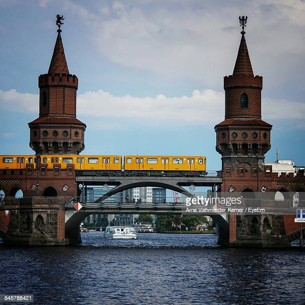 train on oberbaumbruecke over spree river - kreuzberg stock photos and pictures