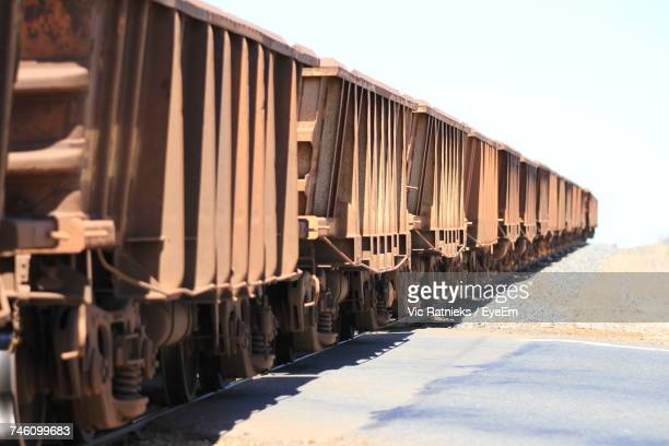 train on railroad track against sky - ratnieks stock pictures, royalty-free photos & images