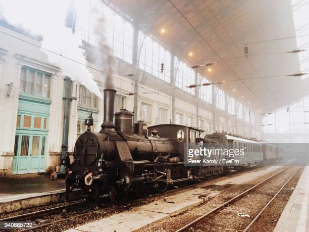 train on railroad track against sky - locomotive stock photos and pictures