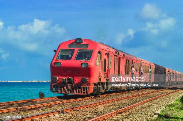 train on railroad track, kollupitiya, colombo, sri lanka. - imagebook stock pictures, royalty-free photos & images