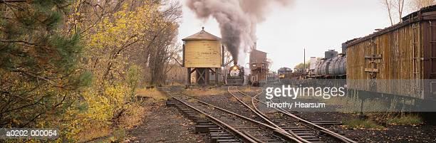 train on railroad tracks - timothy hearsum stock-fotos und bilder