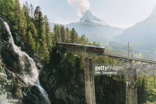 train on the background of matterhorn mountain - europe stock pictures, royalty-free photos & images