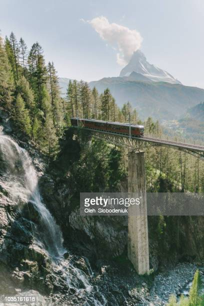 train on the background of matterhorn mountain - matterhorn stock pictures, royalty-free photos & images
