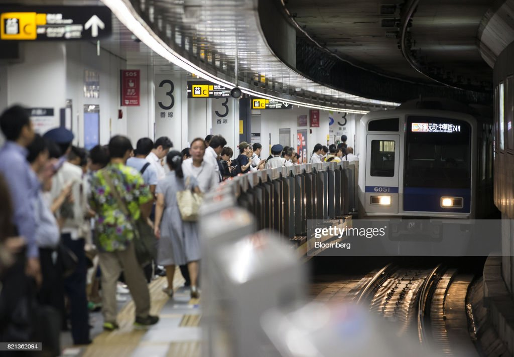 A train on the Toyoko line operated by Tokyu Corp. approaches Shibuya Station in Tokyo, Japan, on Tuesday, July 18, 2017. July 24 marks the first dry run of a 'Telework Day' encouraging people to work from home as the city gears up to host the 2020 Summer Olympics. Authorities are seeking ways to make room for 920,000 spectatorsexpected to visit Tokyo each day during the games. Photographer: Tomohiro Ohsumi/Bloomberg via Getty Images