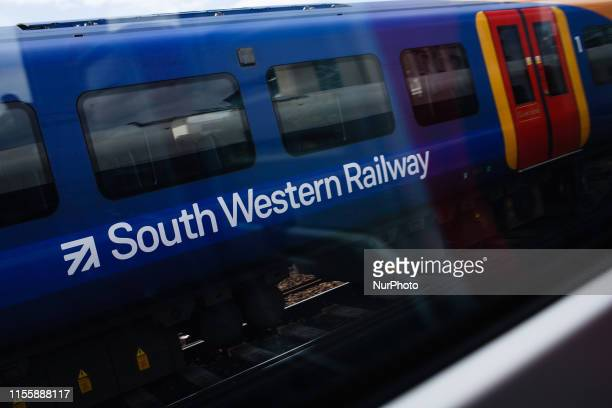 A train operated by South Western Railway heads toward Waterloo Station in London England on July 15 2019 The company remains embroiled in a...