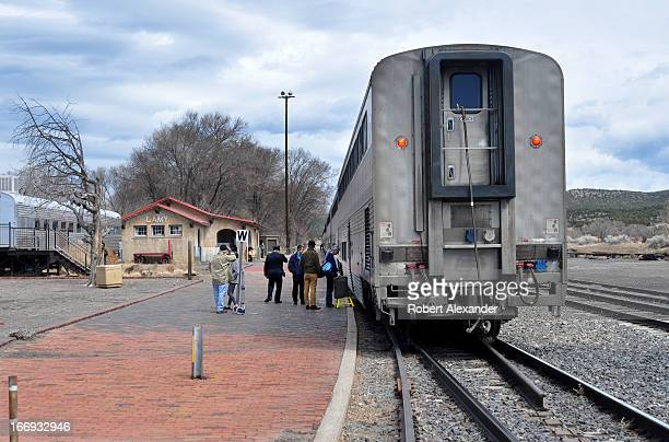 Train passengers board Amtrak's Southwest Chief at the Amtrak station in Lamy New Mexico The train runs daily between Los Angeles and Chicago with...
