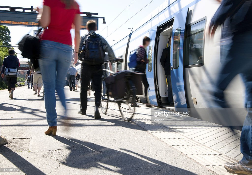 Train passengers entering commuter carriage : Stock Photo