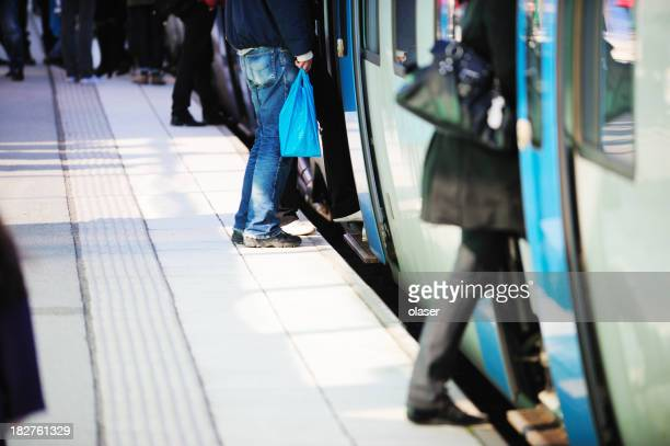 Train passengers entering commuter carriage