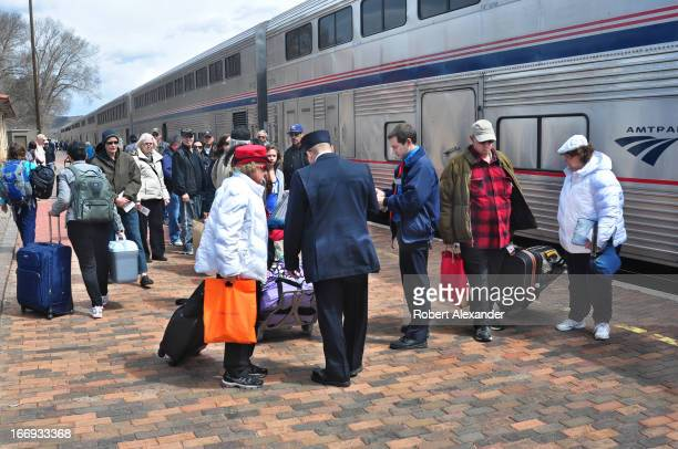 Train passengers prepare to board Amtrak's Southwest Chief at the Amtrak station in Lamy New Mexico The train runs daily between Los Angeles and...
