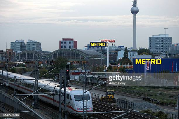 A train passes by a Metro store on October 17 2012 in Berlin Germany Retail business is the thirdbiggest economic sector in Germany and consumer...