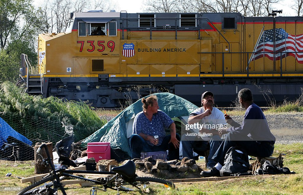 A train passes by homeless people at a homeless tent city March 23 2009 in & Sacramento City Council To Meet On Fate Of Tent City Photos and ...