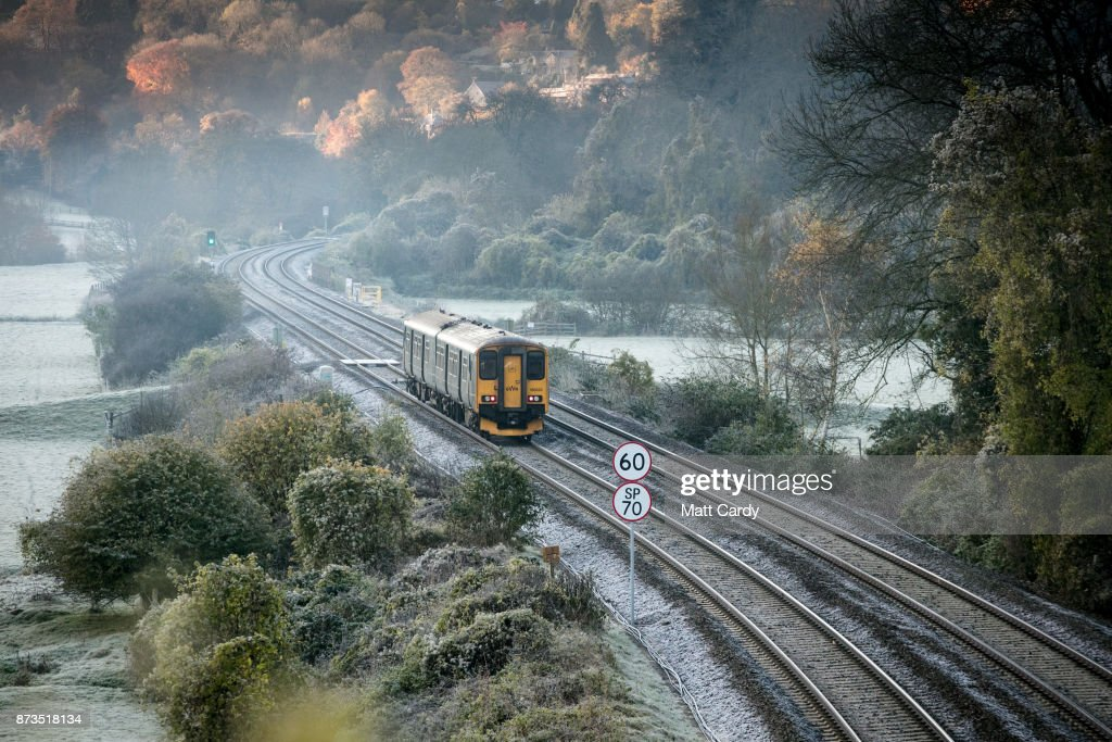 A train passes near to the as frost lingers on the tracks near the Dundas Aqueduct as the sun rises on November 13, 2017 near Bath, England. After a warm autumn, with temperatures above average, much colder weather has arrived in many parts of the UK, signalling the start of more wintery weather for the coming few weeks.