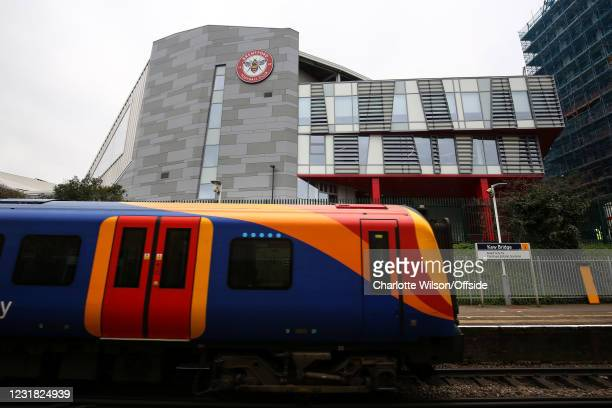 Train passes through Kew Bridge station which neighbours Brentford Community Stadium ahead of the Sky Bet Championship match between Brentford and...