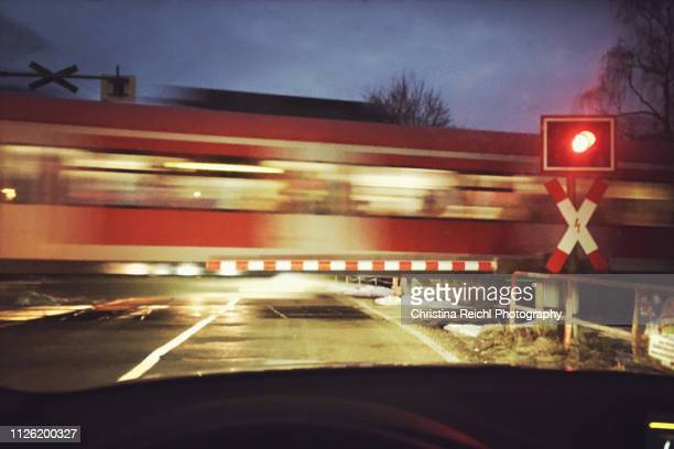 train passing by on railroad crossing - moving past stock photos and pictures