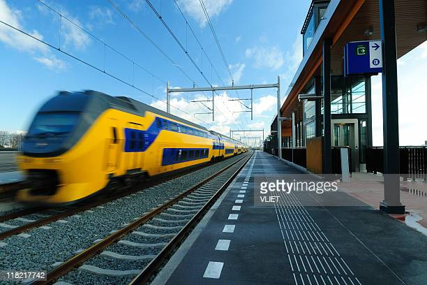Train passing railway station in the Netherlands
